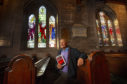 Church elder Archie Milne's new booklet on the history of Brechin Cathedral's stained-glass windows includes tales of suffragette links and tributes to the First World War.