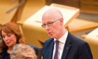 Education Secretary John Swinney has vowed to plough on with the standardised assessments.