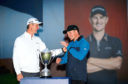 Justin Rose presents the trophy to Eddie Pepperell after winning during day four of the British Masters at Walton Heath Golf Club, Surrey. PRESS ASSOCIATION Photo. Picture date: Sunday October 14, 2018. See PA story GOLF Masters. Photo credit should read: Steven Paston/PA Wire. RESTRICTIONS: Editorial use only, No commercial use without prior permission.