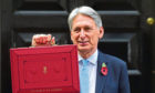 Chancellor Philip Hammond holding his red ministerial box before delivering the Budget.
