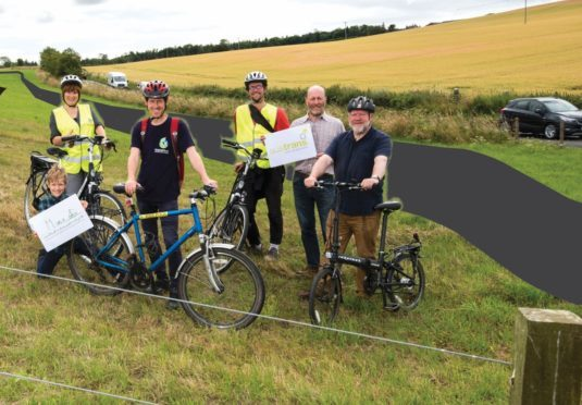 Supporters of the project on part of the proposed route near St Andrews.