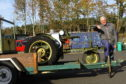 SVVC chairman Allan Burt with a Gunsmith light tractor in the auction