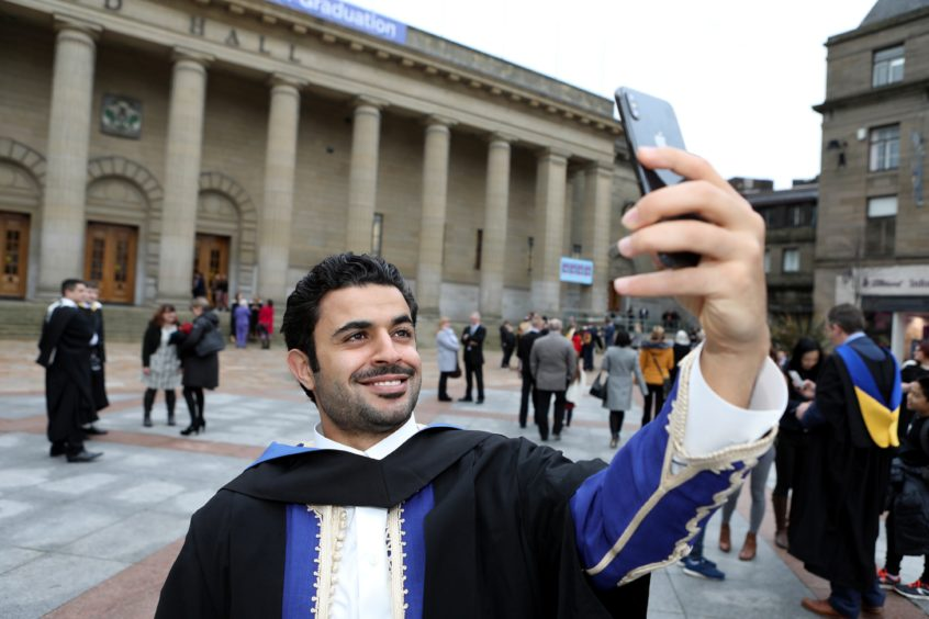 Abd Etbiga, 25 from Libia marks his finance degree with a selfie.