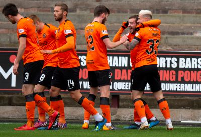 The United players celebrate Paul McMullan's opening goal.