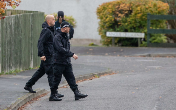 Police go door-to-door in Highland Road, Crieff, near where Martyn Cruickshank was last seen.