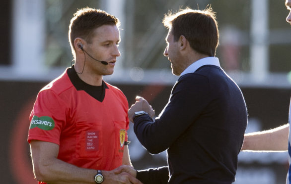 Dundee manager Neil McCann (right) remonstrates with referee Steven McLean at full time.