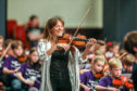 Nicola Benedetti and Big Noise perform with 320 children at Festival of Strings Dundee earlier this year.