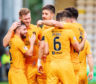 Livingston celebrate one of their four goals against Dundee.