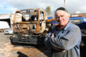 Owner of Bolts garage Bob Coote with the burnt out recovery truck.