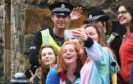 Students take a selfie with the police