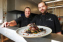 Eden Sinclair and head chef Jordan Sinclair with their dish of wood pigeon, wild mushroom, black pudding and red currant jus.