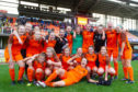 The United women's team celebrate their title triumph.