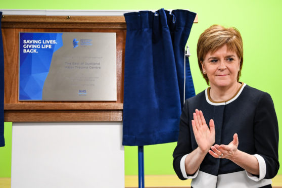 Nicola Sturgeon unveils a plaque marking the official opening of the new trauma centre at Ninewells Hospital.
