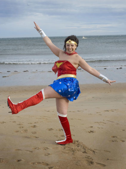 Children In Need hit East Sands in St Andrews thanks to Wonder Woman—alias Claire Maindron.  Claire, who worked at the refreshment kiosk at the East Sands donned the costume to raise money.