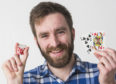 Richard Sim with his winning cards