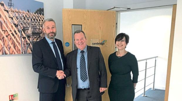 Donaldson Timber Engineering managing director Jonathan Fellingham with Cambridge Roof Truss managing director Jack McMinn and director Sue Mills.