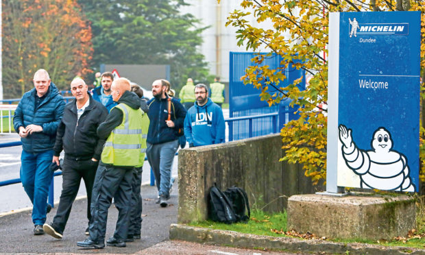 Staff leave Michelin Factory in Dundee after the closure announcement.