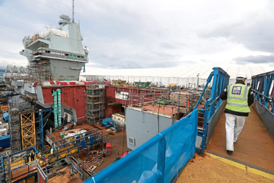 Work continues during a tour of the under-construction aircraft carrier, HMS Prince of Wales, at Babcock's site in Rosyth, Fife.