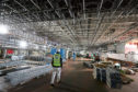 Work continues in the hanger area during a tour of the under-construction aircraft carrier, HMS Prince of Wales, at BAE Systems in Rosyth, Fife. PRESS ASSOCIATION