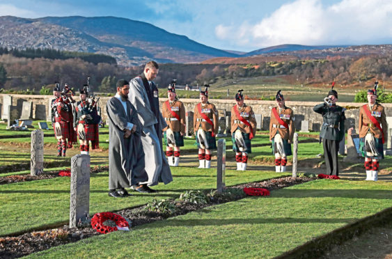 Iman Asim Hafiz and the Rev Duncan MacPherson attend Scotland's first multi-faith remembrance service for British Indian Army soldiers at Kingussie Cemetery in Badenoch on Thursday November 15.
