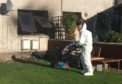 A forensic investigator at the scene of the tragedy