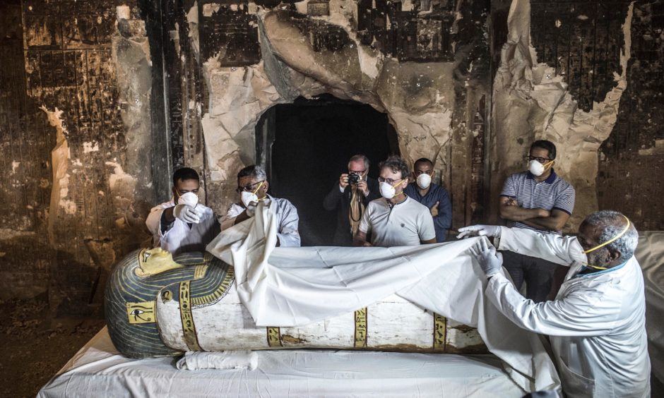 People inspect an intact sarcophagus during its opening at the site of Tomb TT33 at Al-Assasif necropolis on the west bank of the Nile north Luxor, Egypt. Khaled Desouki/Getty Images