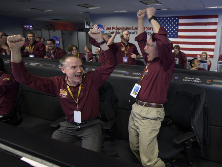 The command team celebrate after the Mars InSight lander successfully touched down on the surface of Mars. Bill Ingalls/NASA