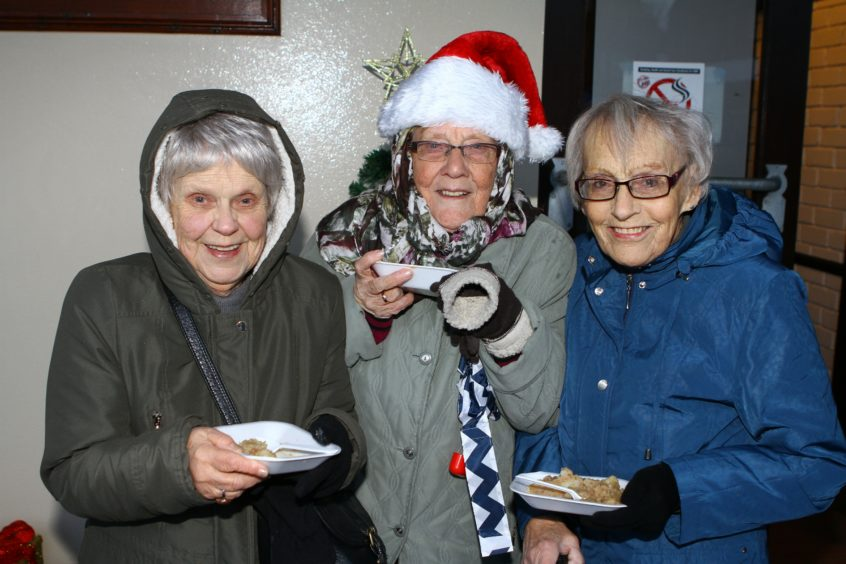 The Monifieth xmas lights switch on over the weekend.   Margaret Whyte,Evelyn Petrie & Edna Ross enjoying some stovies.