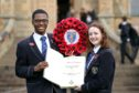 Head boy Ebu Omenuko and head girl Robyn White with the book ahead of the ceremony