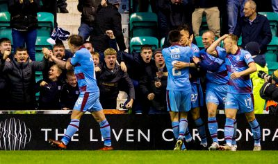 Paul McGowan and the Dundee players celebrate the equaliser.