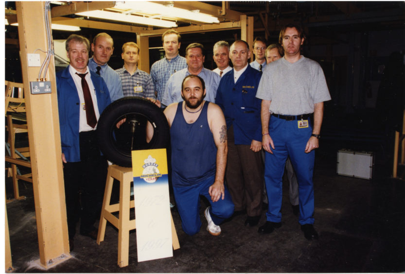 John Greig and colleagues with Michelin's anniversary tyre on 6/11/1997.