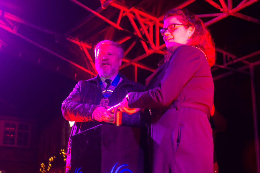 Callum McLeod, Chair of the Community Council,  and Depute Provosot for Fife Julie Ford switch on the lights.