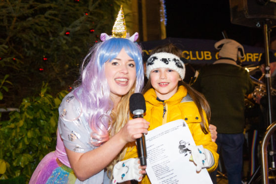 Princess Unicorn Chloe Leuchars and six-year-old Aimee Carr sing at The Cross