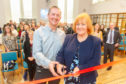 Colin Robertson performs the ribbon-cutting duties alongside Baillie Helen Wright.