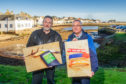 Graham James and George Anderson (left), of Plastic Free Anstruther, give a glimpse of the exhibition