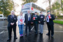 Christine Evans (Area Organiser for Poppy Scotland) and Provost Jim Leishman  with the new bus decorated in remembrance poppies, Pittencrieff Park, Dunfermline, 30th October 2018.