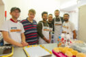 The Taught by Muhammed Kirkton support cafe in action - l to r - volunteers - Kevin Marnie and Stevie Lee, with volunteers and project managers within the organisation - Umer Farooq, Faisal Hussein, Isa Mallick and Rizwan Rafik.