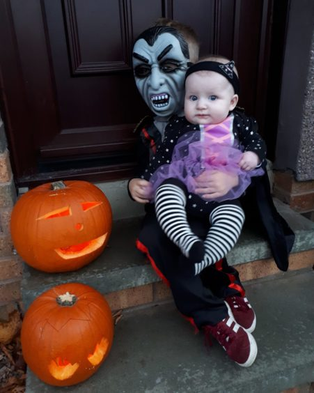 Kaiden, 4, and Keira, 5 months, preparing to spook their neighbours.