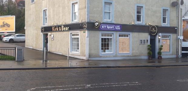 The windows were still boarded up on Thursday, but the owners will not be cowed.