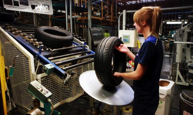 A Michelin Dundee technician checks a tyre