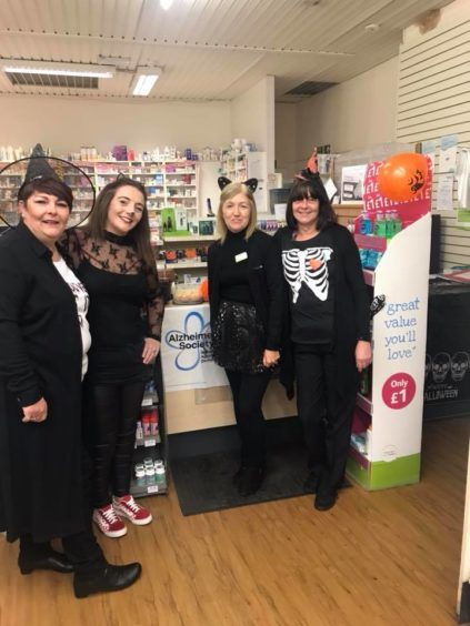 Even the staff at Lloyds Pharmacy in Lochee got involved - all in the name of fundraising.