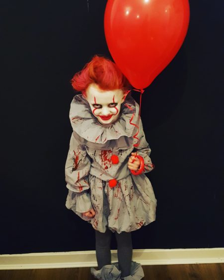 Have you seen a better Pennywise costume than this one worn by Lola, 5?