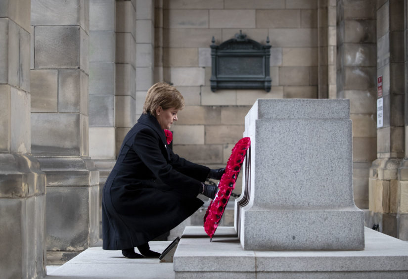 First Minister Nicola Sturgeon lays a wreath at the Stone of Remembrance at the City Chambers, Edinburgh, on the 100th anniversary of the signing of the Armistice which marked the end of the First World War.