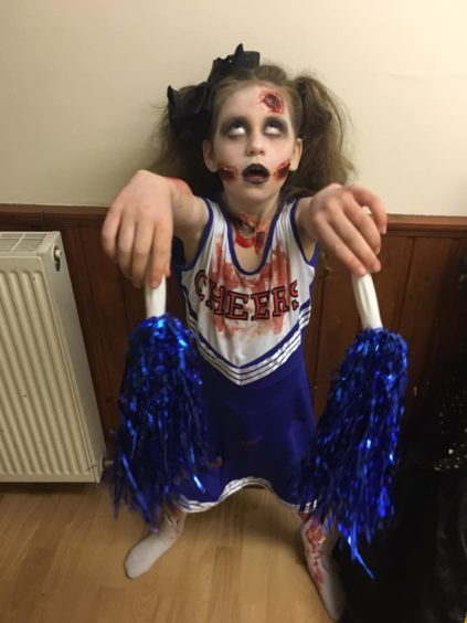 Madison looked the part as a zombie cheerleader.