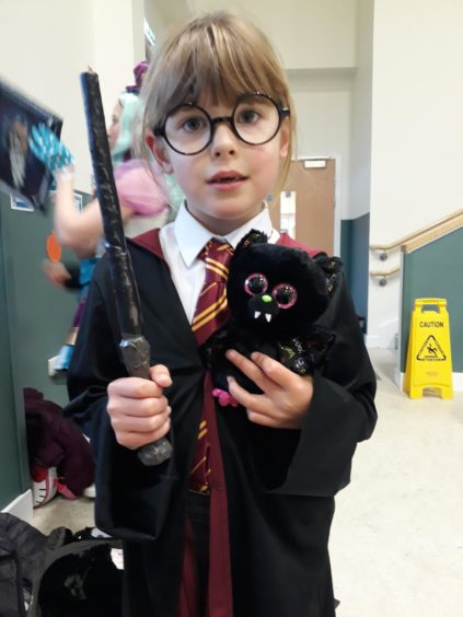 We're told Morgan, 6, didn't want to dress as Hermione - so she went as Harry Potter instead!