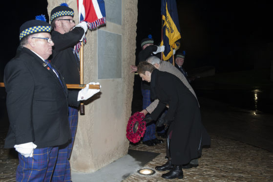 Carol MacDonald lays a wreath at the memorial to the Carnoustie VCs