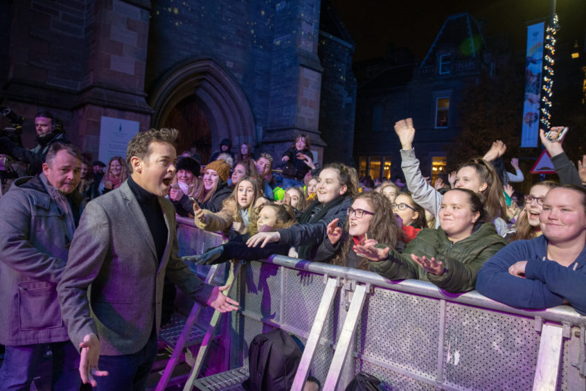 Stephen Mulhern meets and has selfies with the public during the City of Perth Winter Festival.
