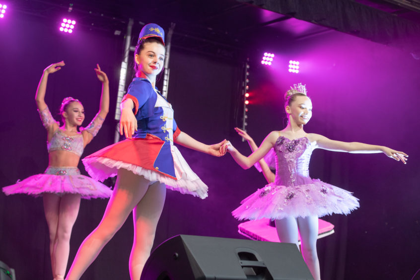 The dancers from the Julie Young School of Dance perform on the Year of the Young People Stage.