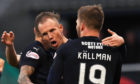 Kenny Miller celebrates his goal with Benjamin Kallman.