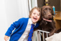 Ava Stark and her dog, Lola.